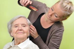 caregiver combing her patient